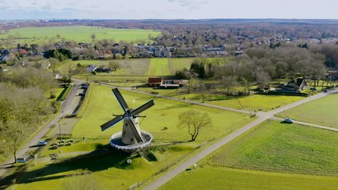 Aerial drone view on the typically Dutch windmill De Windhond in Soest. Traditional Dutch rural farmland landscape.