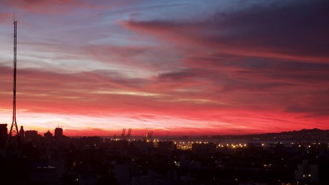 Time lapse of red clouds and radio tower in Montevideo Uruguay