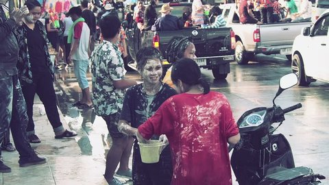 BANCHANG, RAYONG, THAILAND - APRIL 17,2019 : Songkran festival, People and children playing powder and water, water gun, dancing on truck and on the road at Songkran festival in Thailand