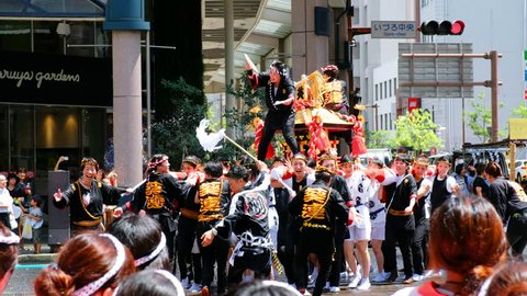 KAGOSHIMA, JAPAN - JULY 22, 2018: Religious festival at the streets of Kagoshima, Japan during the day. Kagoshima is a popular touristic city of Kyushu island. Women shout wearing traditional clothes