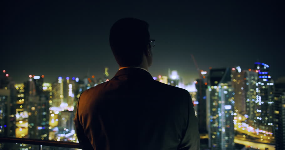 Young Businessman Looking At Business Buildings Skyline Rooftop Urban City View Finance Leadership Night City Lights Slow Motion Red Epic 8k | Shutterstock HD Video #1027882841