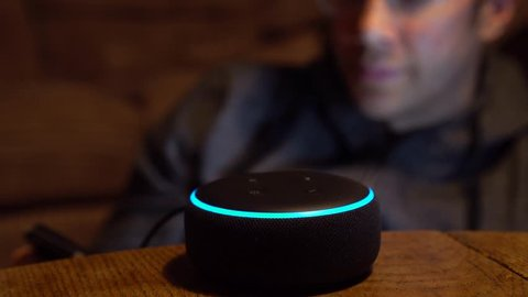 Smart Voice Command Activation Device Used By Man In Living Room, 4K.