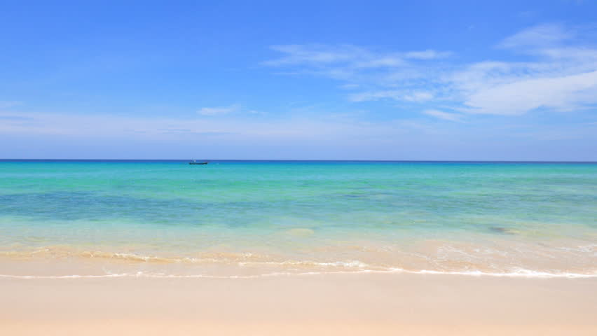 Blue sky with clouds with waves rolling onto an island beach | Shutterstock HD Video #1027948511