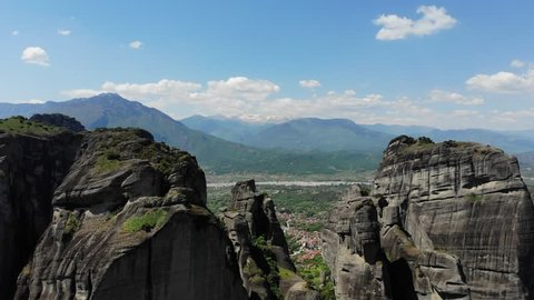 Fly through amazing Meteora rock formation in Mountains in Greece
