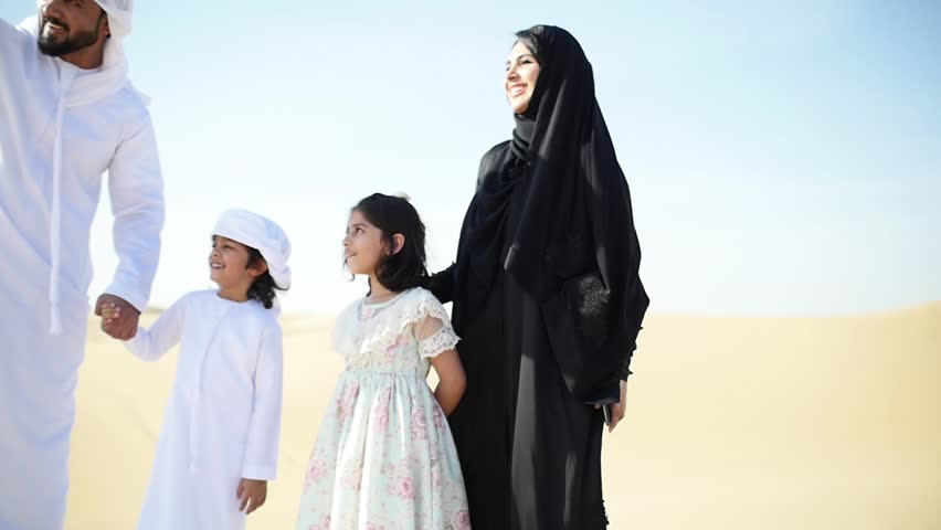 Happy muslim family spending weekend making safari in the dubai desert. Parents and kids having good time. lifestyle moments | Shutterstock HD Video #1027983671