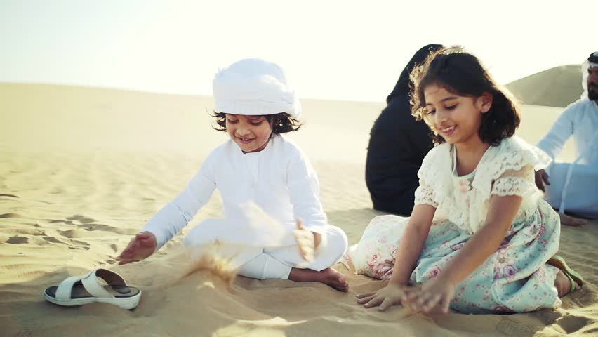 Happy muslim family spending weekend making safari in the dubai desert. Parents and kids having good time. lifestyle moments
