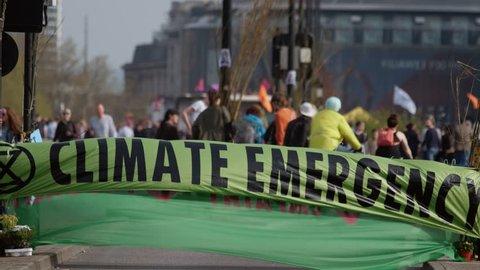 LONDON, circa 2019 - Extinction Rebellion demonstrators occupy Waterloo Bridge in London, UK to raise awareness to the danger of Climate Change