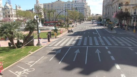Flying on an empty main street in Valencia Spain on a double-decker bus.