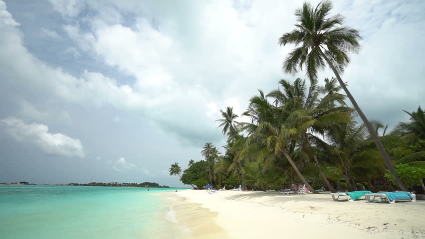 Empty beach with the turquoise ocean and the nature in the background. | Shutterstock HD Video #1028039351