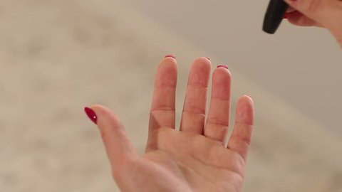 Close-up of a girl piercing his finger with a scarifier to check the level of glucose in the blood. Control diabetes at home with a glucometer. A drop of blood. Blood sampling for glucometer.