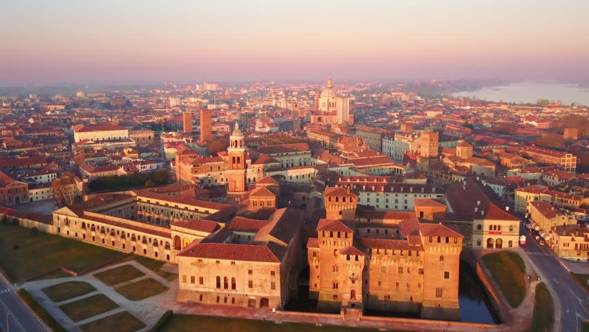 Mantua skyline aerial view flying backwards from ducal palace at sunrise | Shutterstock HD Video #1028188631