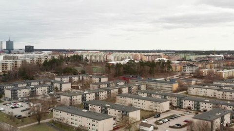 Drone aerial view of Rinkeby, Tensta in Stockholm, Sweden. Ghetto like concrete jungle buildings in suburb. Dangerous place no go zone