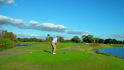 Playa del Carmen, Quintana Roo / Mexico - July 1, 2016: Man Taking Golf Swing on Mexican Golf Course, Playa de Carmen, La Playa, Mexico