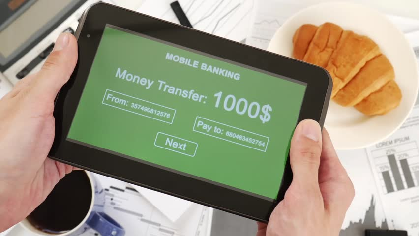 Businessman makes a money transfer through a mobile bank. Internet banking. Business lunch. Custom green interface design | Shutterstock HD Video #1028255531