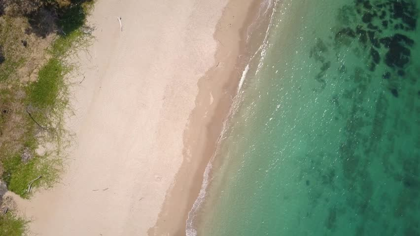 Aerial shot of turquoise waters washing up at white sandy beach Thailand - camera rotating with pedestal down / zoom | Shutterstock HD Video #1028292251