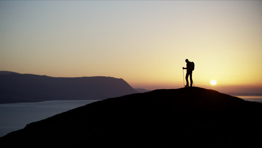 Silhouette of fit Caucasian European female hiker walking mountains outdoor Snowdonia National Park Wales United Kingdom RED MONSTRO #1028326331