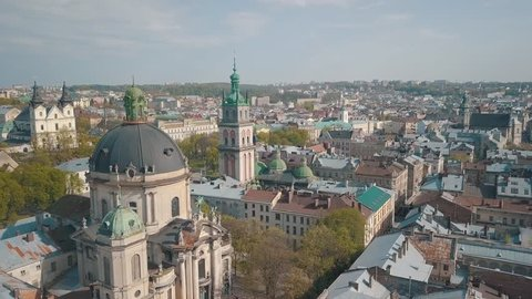 Aerial Roofs and streets Old City Lviv, Ukraine. Central part of old city. European City in spring. Densely populated areas of the city. Panorama of the ancient town. Ukraine Dominican. Drone shot