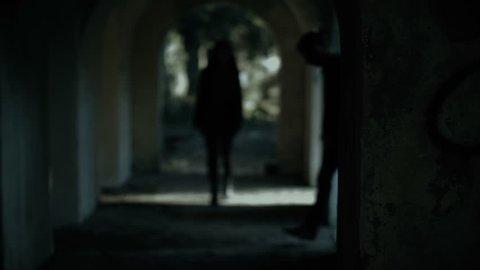 Woman walking alone dark tunnel.Man attacking her.Violence against women,rape