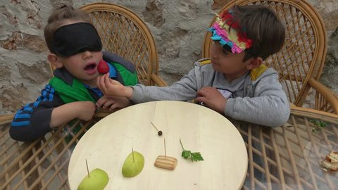 Fethiye, Turkey - 7th of April 2019: Guess what food challenge - 4K Two friends play blindfold in guess what food, cryctal child