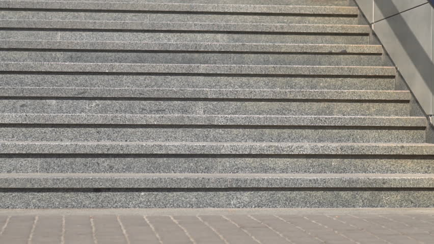 Granite steps in a city park on a sunny day. Staircase outside. Vision up the stairs. Close-up