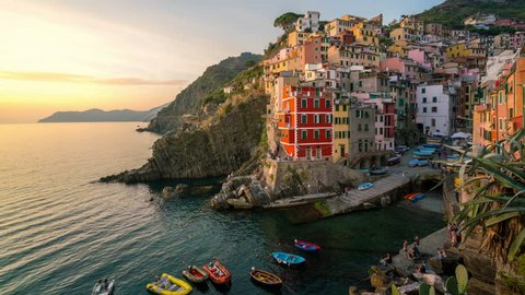 Sunset time lapse of Riomaggiore in Italy - Riomaggiore is a traditional fishing village in La Spezia, situated in valley in Liguria of Italy. Riomaggiore is one of Cinque Terre travel village.
