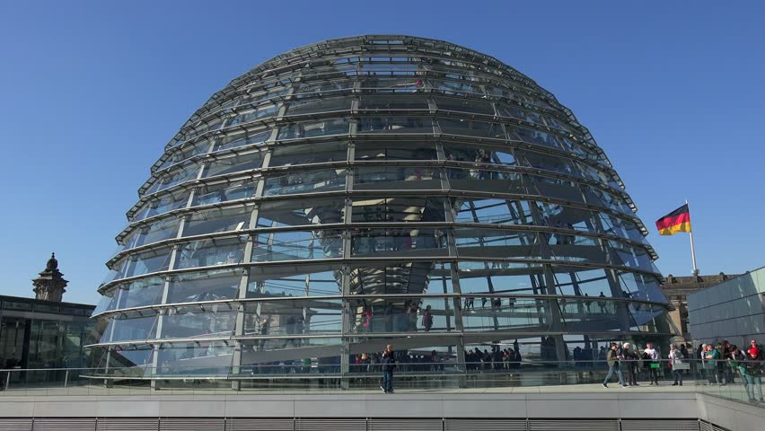 BERLIN/Germany, April, 2019: Visitors inside the famous Reichstag glass dome building, on the top of the Reichstag, designed by architect Norman Foster, one of Berlin's most important landmarks