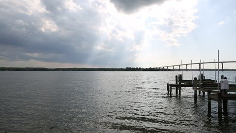 Pier and Bridge at Bay of Patuxent River in Solomon's Island, Maryland.