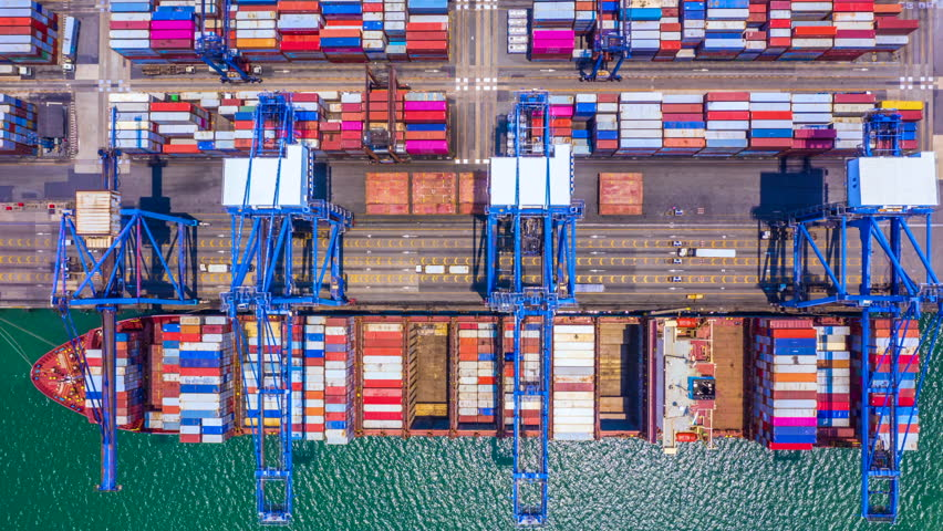 Container ship loading and unloading in deep sea port at China, Aerial top view of logistic import export transportation business by container ship in open sea, Time lapse aerial view 4k, China. | Shutterstock HD Video #1028578241