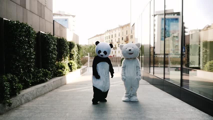 Panda and polar bear dancing in the city to demonstrate and protest against world pollution and animal rights | Shutterstock HD Video #1028599331