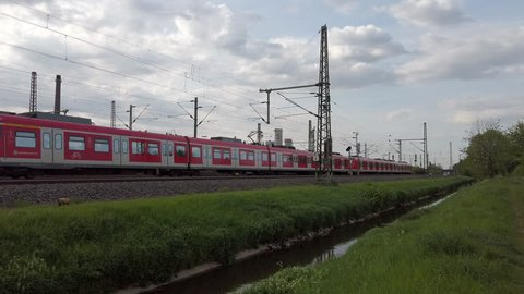DUSSELDORF, GERMANY - APRIL 24, 2019: Two Deutsche Bahn passenger trains pass the same stretch of track through Dusseldorf, Germany.