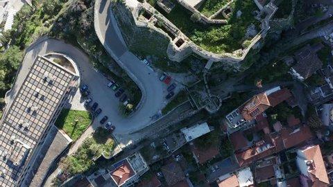 Aerial top view, Car travels old road of Nafplio, seaside town in Greece 4k