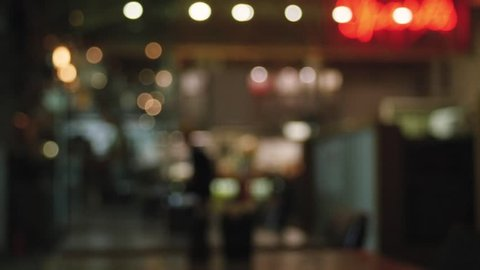 Blurred background of restaurant with abstract bokeh ligh