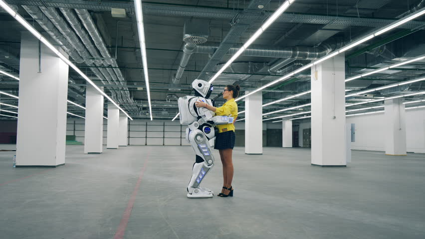 Human-like cyborg and a lady are holding each other | Shutterstock HD Video #1028673161