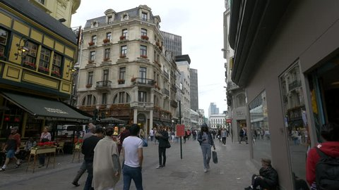 Belgium, Brussels - October, 2016: People walking on Rue des Fripiers and Rue Grétry in Brussels