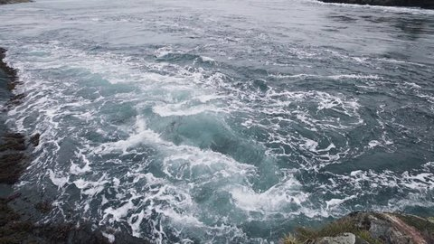 Saltstraumen is a small strait with one of the strongest tidal currents in the world. It is located in the municipality of Bodø in Nordland county, Norway. filmed close to the water