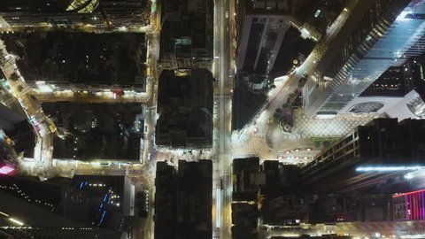 HONG KONG - MARCH, 2019 : Aerial overhead view of Hong Kong Wan Chai downtown streets by night, cars, people