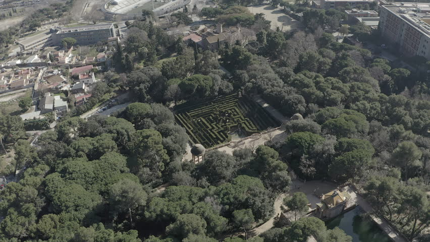 Detail of the Labyrinth Park of Horta on a beautiful sunny day. Barcelona. Spain. Aerial view orbit | Shutterstock HD Video #1028704691