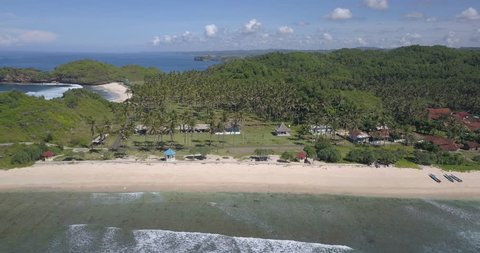 Srau beach in pacitan east java which has the beauty of white sand and coconut trees