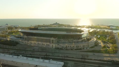 Chicago, Illinois / USA - April 28, 2019: Orbit Zoom over Soldier Field during Sunrise [4k] [Editorial]