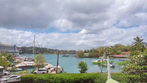 Castries, St. Lucia - MAR 11, 2019: Timelapse with yachts and boats nearby pier