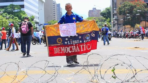 Caracas/Venezuela, May 1, 2019: Workers claims for higher salaries and the resignation of Nicolas Maduro on international working day in Caracas, Venezuela