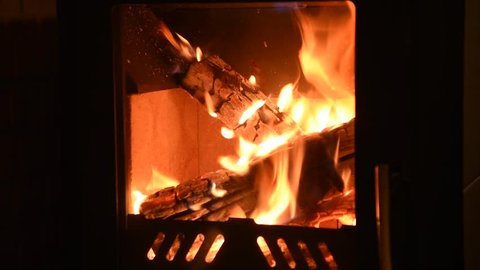 Fire burning in the fireplace. fireplace full of fire wood and fire. Cold winter, kindling furnace, country holiday, comfort, warmth of fire, rest at the furnace.