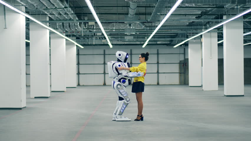 Robotic anthropoid and a lady are holding each other | Shutterstock HD Video #1028988341