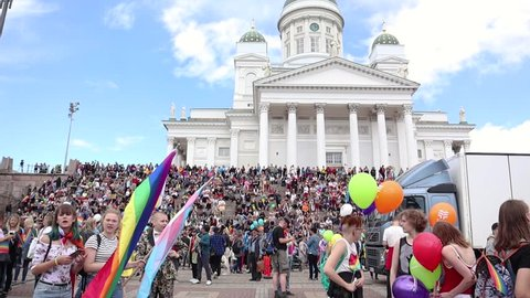 Helsinki, Finland - June 30, 2018: People with rainbow flags and air balloons at the Senate square of Helsinki during the Gay pride parade.