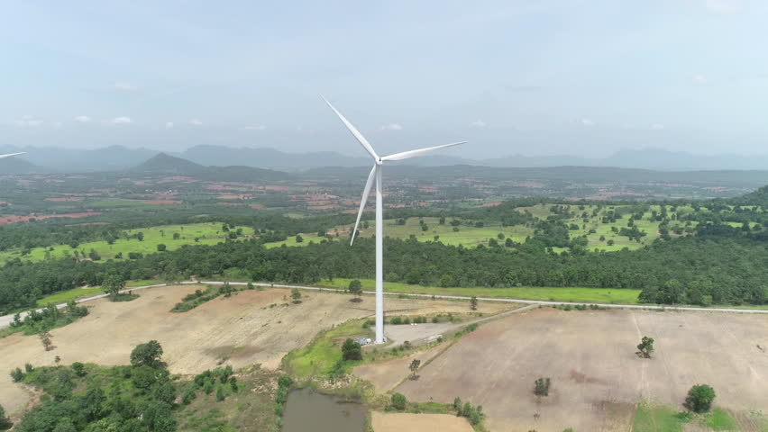 Aerial drone view of wind turbine farm. Green power, environment friendly and renewable energy concept
