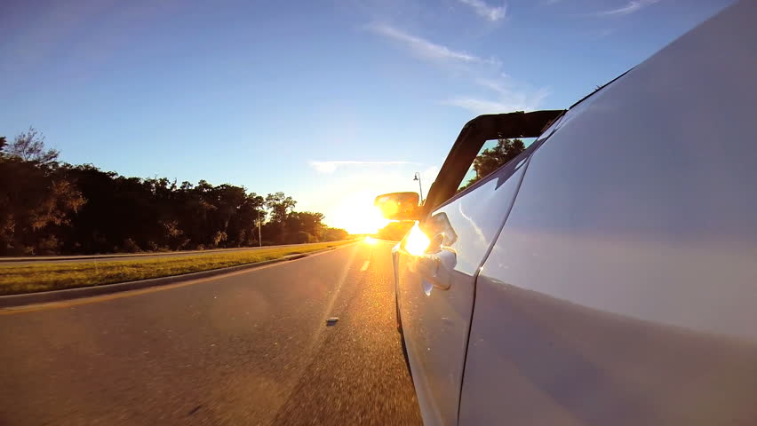 Gopro Perspective Of Car Driving On Sunset Highway Stock Footage