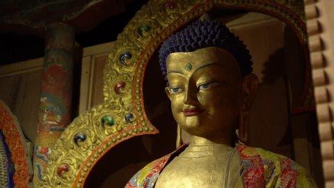 extreme close-up,  upper still shot of Maitreya Buddha's large decorated golden statue at Thiksey monastery, Ladakh.