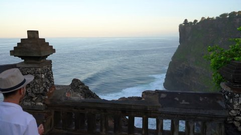 Landmark of Bali: Uluwatu Temple one of six key temples Bali, where every traveling tourist can meet wild monkey and enjoy the breathtaking view of Hindu temple located on the top of mountain cliff