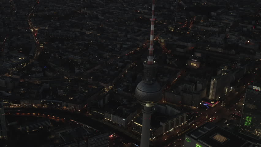 AERIAL: Over Berlin Germany TV Tower Alexanderplatz at Night with City Lights traffic 4K