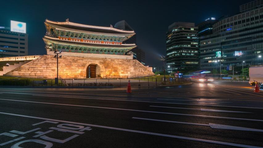 Timelapse Sungnyemun gate (Namdaemun Market) or Namdaemun gate with light trails of car at night in Seoul, South korea. | Shutterstock HD Video #1029294311